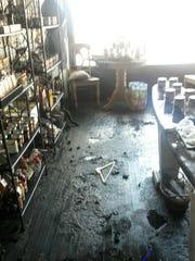 Damage inside of Alyssa Cope's Honeygirl Gourmet shop.