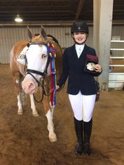 Emmersen Cook, 15, of Silverton is a rising star in the equestrian arena.