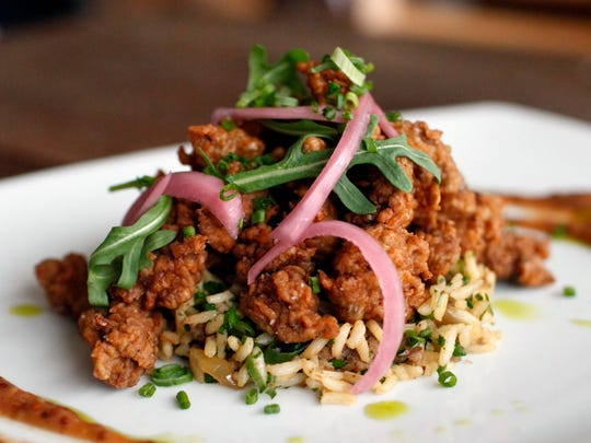 "Chicken livers with ""dirty"" rice at Harvest, 624 E. Market St."