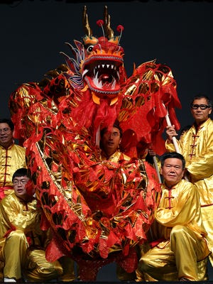 The Indianapolis Chinese Community Center dancers perform the Dragon and Lion Dance during the 2016 Indy Chinese New Year Gala at Carmel High School.