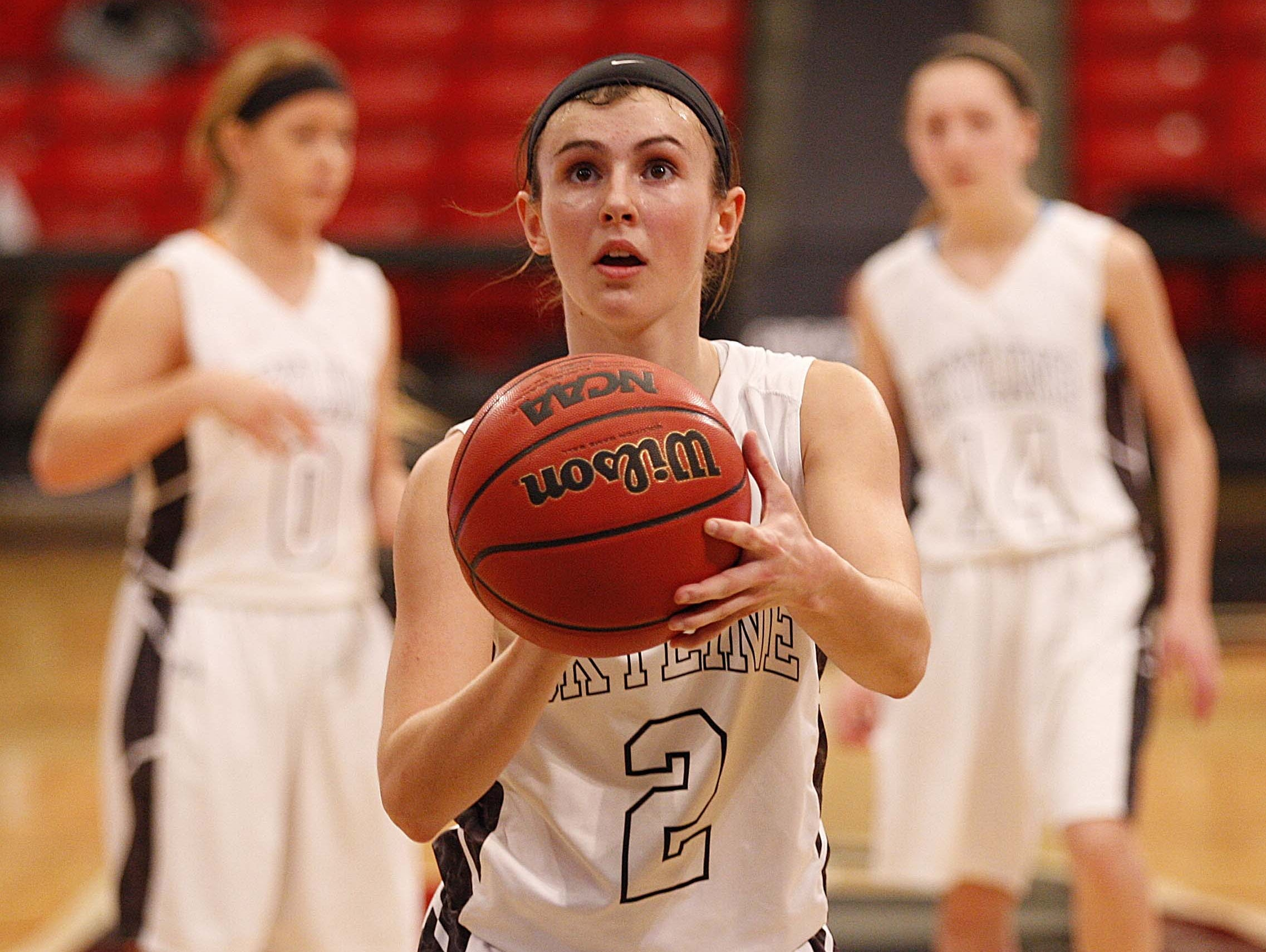 Kaylee DaMitz, center, and the Skyline Tigers won the state title with their smothering defense.