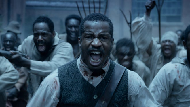 "Nate Parker (front) co-wrote, produced, directed and stars in ""The Birth of a Nation."""
