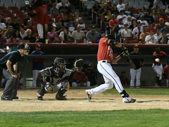Luke Tendler hitting a home run.