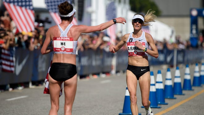 Amy Cragg (left) congratulates Shalane Flanagan as she crosses the finish line during the U.S. Olympic marathon trials on Saturday.