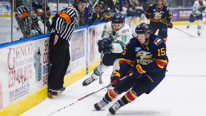 Everblades forward Steven Lorentz trails behind Eagles defender Nicolas Meloche during game 4 of the Kelly Cup Finals against the Colorado Eagles at Germain Arena on Friday, June 1, 2018.