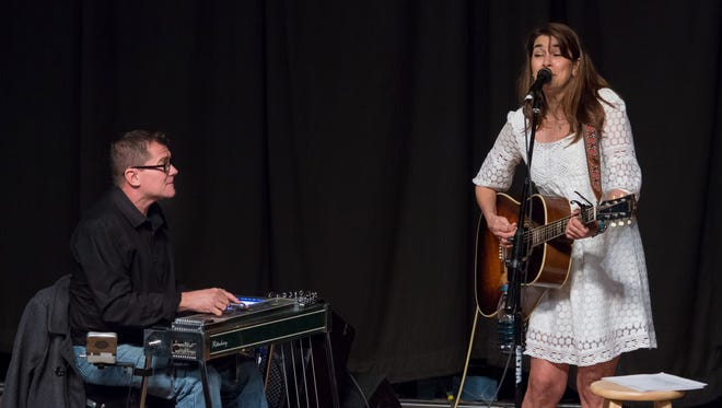Richard Comeaux, left, and Yvette Landry entertain Wednesday at Acadiana Roots.