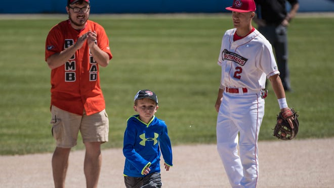 Lakeview graduate Gavin Homer watches as a youngster rounds second base second base at C.O. Brown Stadium during the annual Battle Creek Bombers Kids Day on Tuesday.