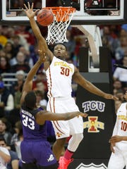 Iowa State guard Deonte Burton (30) swats the ball away as TCU forward Chris Washburn (33) shoots Friday, March 10, 2017 during the semifinals of the Big 12 Men's Basketball Championship in Kansas City.