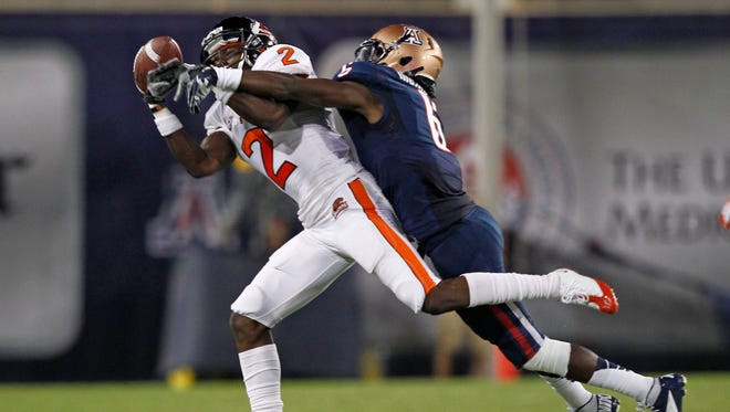 Arizona Wildcats' Jonathan McKnight breaks up a pass intended for  Oregon's Markus Wheaton during the first half of their game Saturday, Sept. 29, 2012 in Tucson.