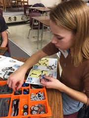 A student in the Plymouth High School STEM Girls Rock