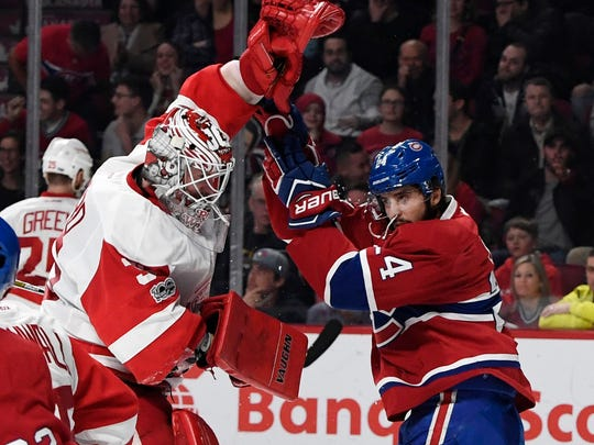 Red Wings goalie Jimmy Howard (35) and Canadiens forward