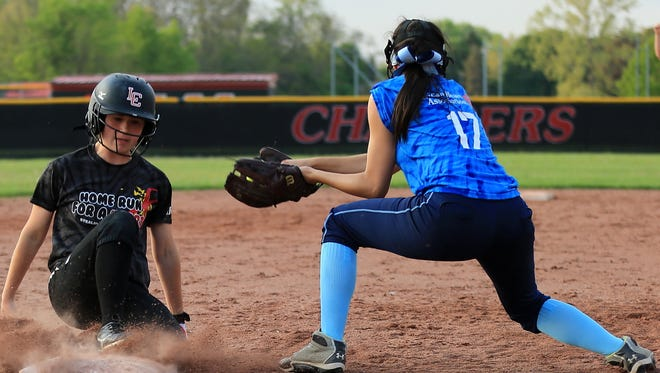 Churchill's Cassie Campbell slides safely into third ahead of the tag of Stevenson's Cori Wilson.