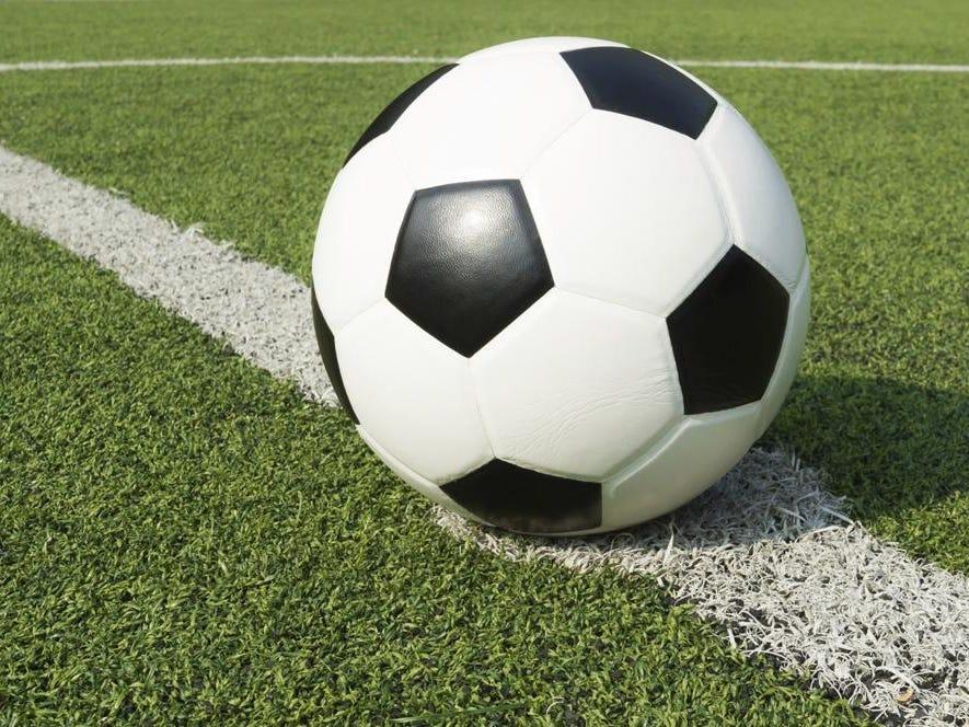 Football on white line