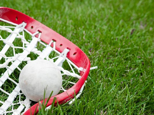 lacrosse stick_ball_grass