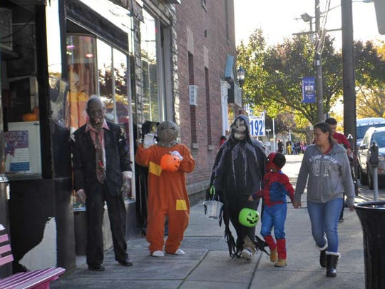 Trick or treaters on Oct. 31, 2017.