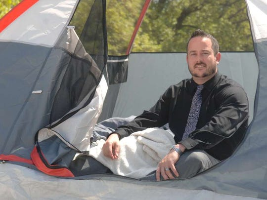 Principal Kurt Schweitzer in a file photo of him getting ready to spend the night on the roof of Union School in Rutherford to reward students who read 10,000 news articles in one year.