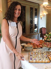 Gina Thompson, executive director of Mary's Shelter with some of the scrumptious food from Ooh La La Caterers.
