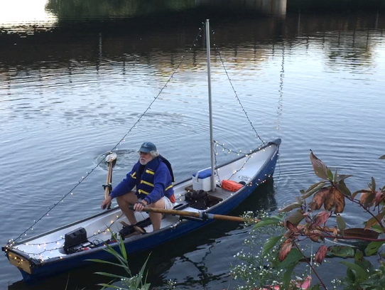 Jim Carrier casts off into the Winooski River on Friday