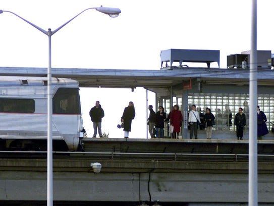 - Commuters wait for a PATCO Hi-Speedline train on