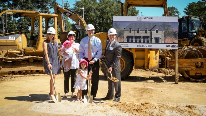 The Albriton family breaks ground for a stand-alone Albriton's Jewelry building in Jackson, within site of the shopping center where the business is now located.