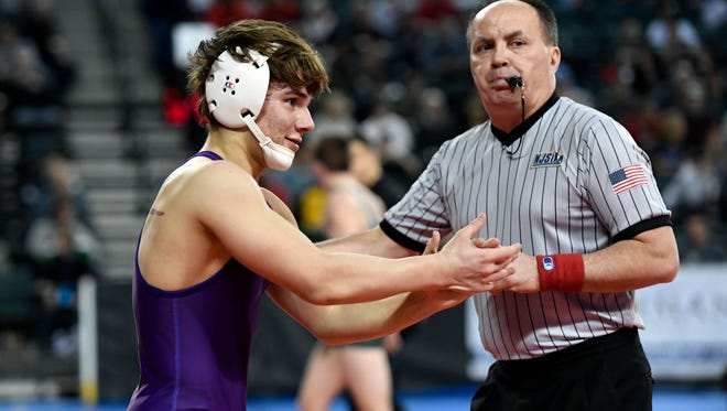 Garfield's Joshua Ferreira applauds after upsetting Delran's Bryan Miraglia in the 132-pound bout during the pre-quarterfinal round of the NJSIAA wrestling championships in Atlantic City, NJ on Friday, March 2, 2018. Ferreira won by decision, 6-2.
