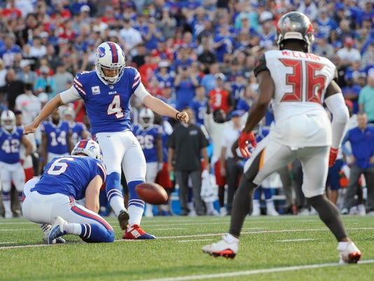 Buffalo Bills kicker Stephen Hauschka (4) boots the winning field goal during the second half of an NFL football game as Tampa Bay Buccaneers defensive back Robert McClain (36) looks on Sunday, Oct. 22, 2017, in Orchard Park, N.Y. (AP Photo/Adrian Kraus)