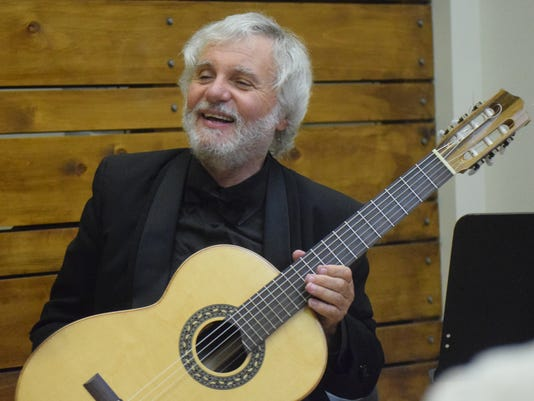Classical guitarist John De Chiaro plays the ragtime music of American composer Scott Joplin at the Nachtmusik Concert Series held Tuesday, Sept. 11, 2018 at Alexandria's Sylvan Center. 