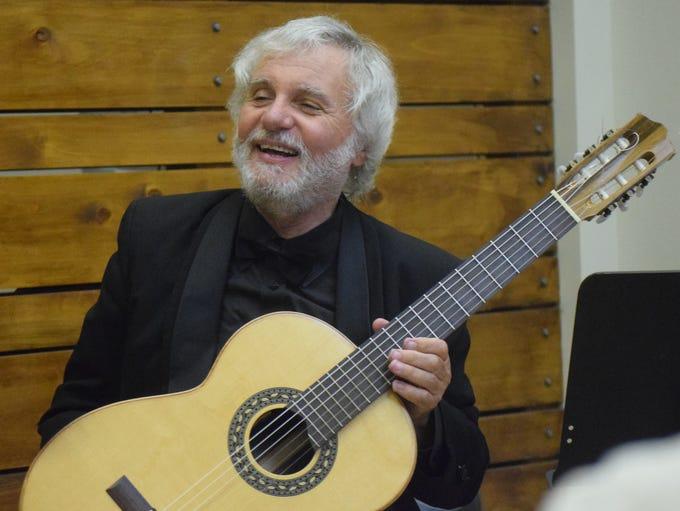 Classical guitarist John De Chiaro plays the ragtime
