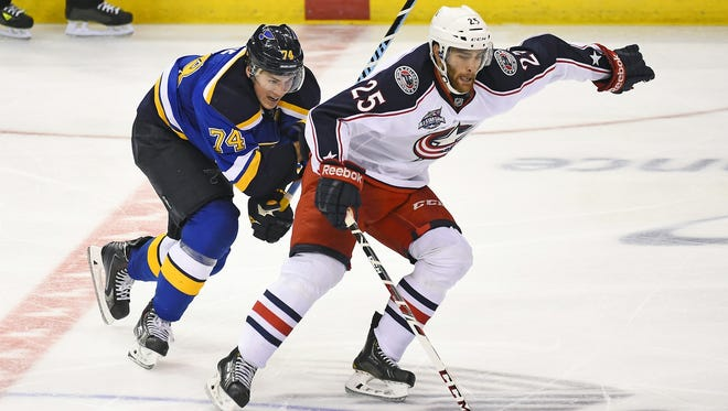 Columbus' Jerry D'Amigo fights to keep the puck in a preseason game last month against St. Louis.