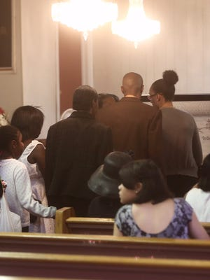 Mourners line up to pay their respects before the funeral of Raynette Turner at Holy Tabernacle Church in Mount Vernon Aug. 7, 2015.