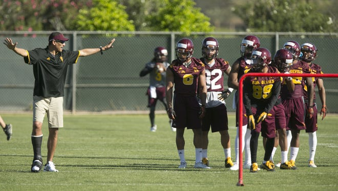 ASU wide receivers coach Jay Norvell coaches during Day 2 of ASU Spring football practice at the ASU practice facility in Tempe on Wednesday, March 16, 2016.