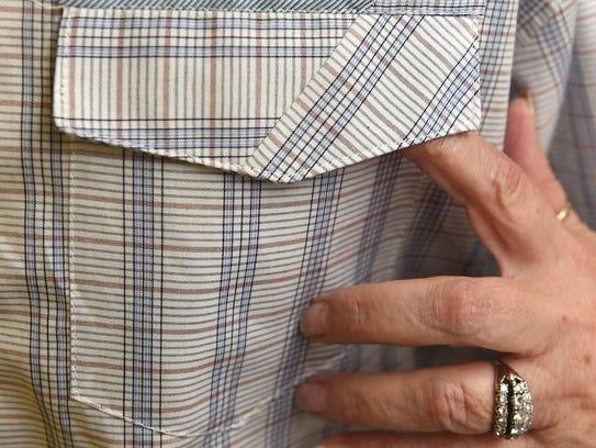 Janet Pray displays a men's shirt pocket pattern that