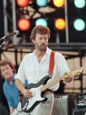 Eric Clapton performs at the Live Aid concert in Philadelphia on July 13, 1985.
