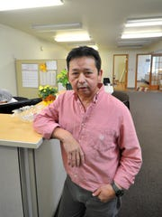 Owner Soua Yang poses for a photo Oct. 18, 2015, at Mekong Fresh Meat in Mosinee.