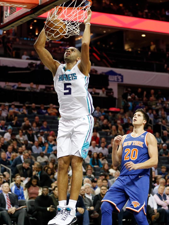 Charlotte Hornets guard Nicolas Batum (5) dunks while facing the New York Knicks during the first half of an NBA basketball game, Monday, Dec. 18, 2017, in Charlotte, N.C. (AP Photo/Jason E. Miczek)