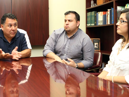 From left, the Rev. Billy Soto, Elijah Guzman, and