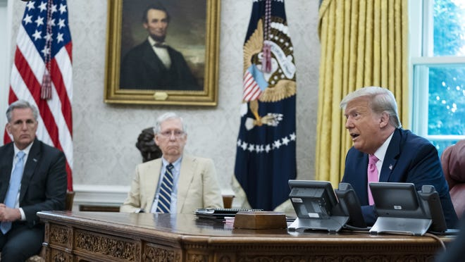 President Donald Trump speaks during a meeting with House Minority Leader Kevin McCarthy of Calif. and Senate Majority Leader Mitch McConnell of Ky. in the Oval Office of the White House Monday in Washington.