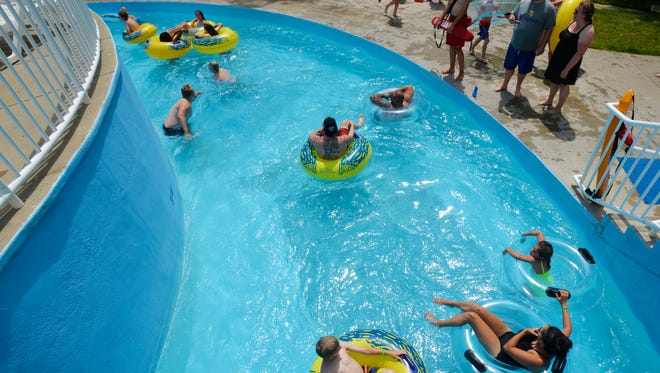 People enjoy staying cool in the lazy river at Electric City Water Park on Friday afternoon as the temperature approaches the 100 degree mark.