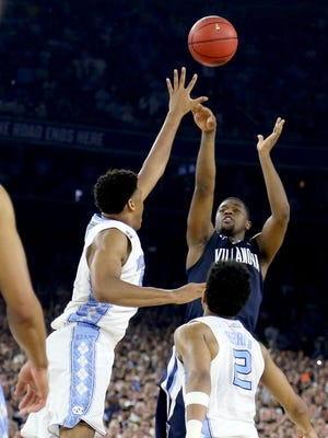 Villanova's Kris Jenkins shoots the game-winning three pointer at the buzzer to defeat the North Carolina Tar Heels 77-74 in the 2016 NCAA National Championship game in Houston.