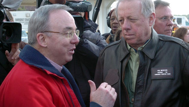 FILE PHOTO FROM 2008: Union University president David Dockery, left, and Tennessee Governor Phil Bredesen, right, speak during a campus tour at Union University following Tuesday's storms Wednesday in Jackson, Tennessee.