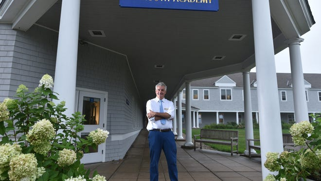 """Falmouth Academy Head of School Matthew Green says the school has the highest enrollment this fall in a decade or more, to the point where it has established a waitlist. The school has created six outdoor classrooms for the coming year. Most inquiries have come from parents considering their options based on their home school district plans. """"Others are thinking twice about returning to New York and Boston,"""" he said."""