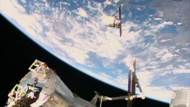 Orbital Sciences' Cygnus commercial resupply craft is on its final approach before being captured.