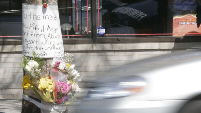 A makeshift memorial to a young woman who was killed in a vehicle that was racing on Yonkers Avenue on April 2, 2006.