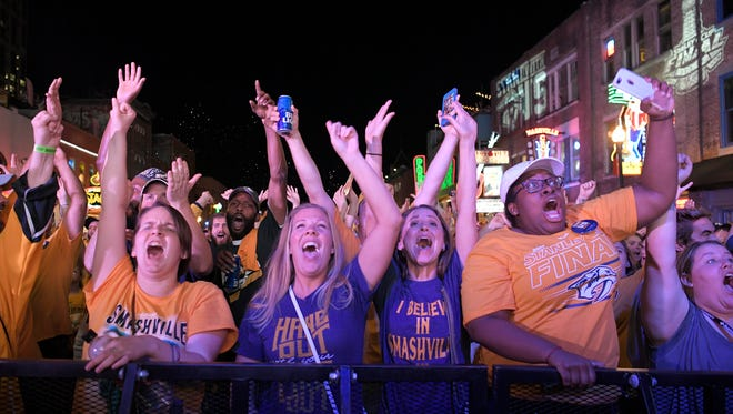 Fans cheer after Preds score fourth goal during Game 4 in the Stanley Cup Final at Bridgestone Arena Tuesday, June 6, 2017, in Nashville, Tenn.