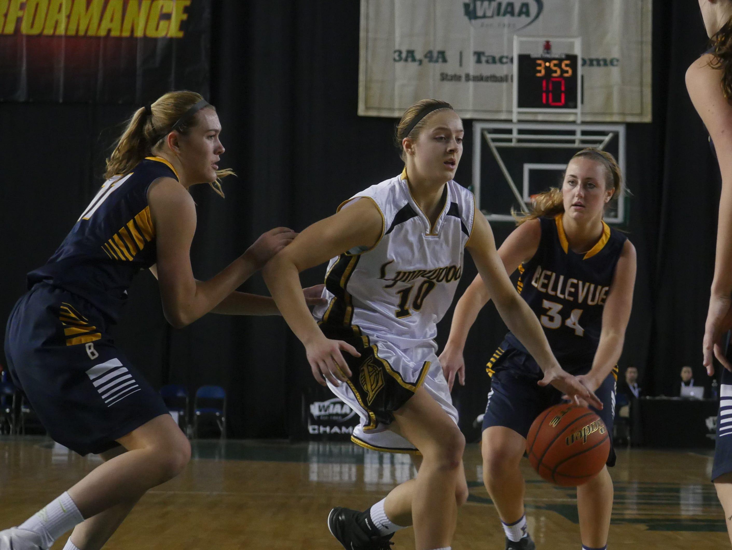 Lynnwood's Mikayla Pivec weaves her way through Bellevue defenders.