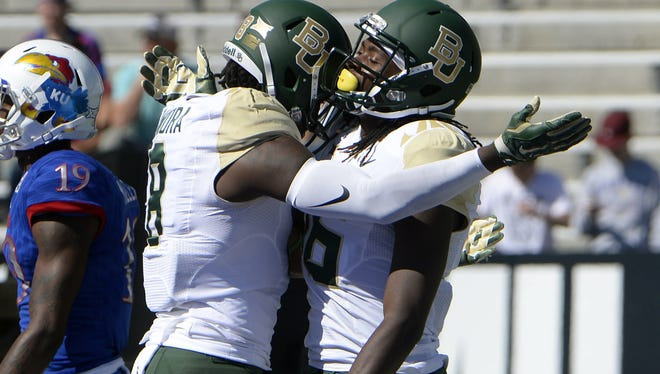Oct 10, 2015; Lawrence, KS, USA; Baylor Bears wide receiver Davion Hall (16) celebrates with wide receiver Ishmael Zamora (8) after scoring a touchdown against Kansas Jayhawks in the second half at Memorial Stadium. Baylor won the game 66-7. Mandatory Credit: John Rieger-USA TODAY Sports