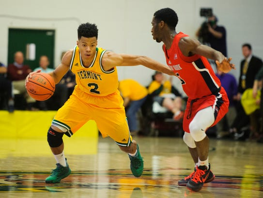 Vermont's Trae Bell-Haynes (2) drives to the hoop past
