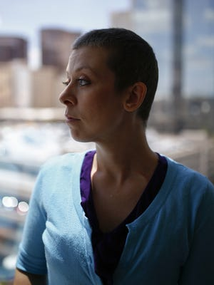 Adobe Mountain teacher Tarah Ausburn is battling cancer and says she was fired from her job when she missed her return date for work. Juvenile Corrections confirmed it had revoked her health insurance, which covered the cost of her cancer treatment.
