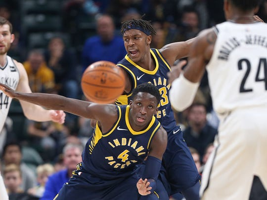 Indiana Pacers guard Victor Oladipo (No. 4) and center Myles Turner (No. 33) work their defense again the Brooklyn Nets during the third quarter of a game at Banker's Life Fieldhousein Indianapolis on Dec. 23, 2017. The Pacers won in overtime, 123-119.
