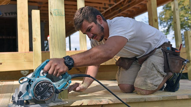 Chris Duffy of E.D. Builders in Vineland operates a power saw on access ramp to the Double Eagle Saloon.